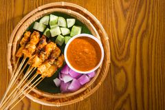 Chicken sate with delicious peanut sauce, ketupat, onion and cuc Royalty Free Stock Photo