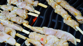 Chicken sate on grill Royalty Free Stock Image