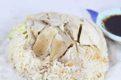 Chicken with sauce over rice Stock Images