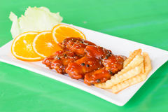 Chicken in a sauce of tomato and pepper. A Chicken in a sauce of tomato and pepper Stock Image