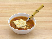 Chicken Sausage Soup With Spoon And Crackers Royalty Free Stock Photography