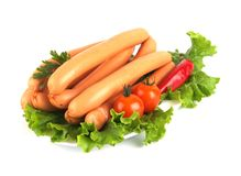Chicken sausages decorated with vegetables. Fresh chicken sausages decorated with vegetables Royalty Free Stock Photography