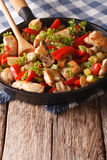 Chicken saute with mushrooms, peppers and zucchini on a frying p Stock Images