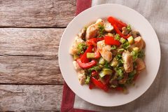 Chicken saute with mushrooms and vegetables close-up. horizontal Stock Images