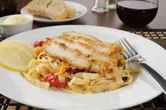 Chicken scalloppini on fettuccine. With sauce Stock Image