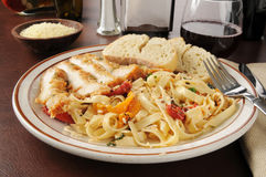 Chicken Scaloppini with Fettuccini. And roasted tomato Royalty Free Stock Photography