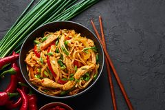 Free Chicken Schezwan Noodles Or Hakka Or Chow Mein In Black Bowl At Dark Background. Schezwan Noodles Is Indo-chinese Cuisine Hot Dish Stock Images - 159221464