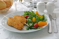 Chicken Schnitzel with arugula and cherry tomatoes Stock Image