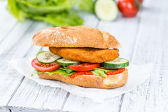 Chicken Schnitzel on a bun Royalty Free Stock Photo
