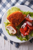 Chicken schnitzel cordon bleu and a salad close-up. vertical top Royalty Free Stock Images