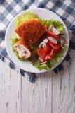 Chicken schnitzel cordon bleu and a salad. vertical top view Royalty Free Stock Photos
