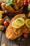 Chicken schnitzel with croquettes Royalty Free Stock Image