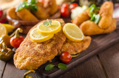 Chicken schnitzel with croquettes Stock Photography