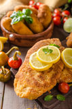Chicken schnitzel with croquettes Stock Images