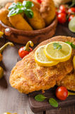 Chicken schnitzel with croquettes Royalty Free Stock Photo
