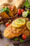 Chicken schnitzel with croquettes Stock Image
