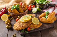 Chicken schnitzel with croquettes Stock Photos