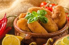 Chicken schnitzel with croquettes. Chicken schnitzel and homemade potato croquettes with cheese and chilli Stock Photo