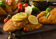 Chicken schnitzel with croquettes Royalty Free Stock Photography