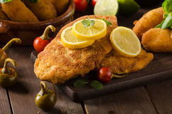 Chicken schnitzel with croquettes Royalty Free Stock Photos