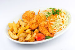 Chicken schnitzel with fries Royalty Free Stock Photo
