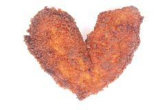 Chicken schnitzel in heart shape Stock Image
