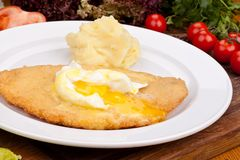 Chicken schnitzel with mashed potatoes on white plate. Close up royalty free stock photography