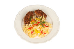 Chicken schnitzel and pasta. Schnitzel and pasta on a white plate Royalty Free Stock Images