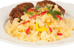Chicken schnitzel and pasta. Schnitzel and pasta on a white plate Royalty Free Stock Photography