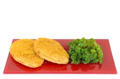 Chicken Schnitzel on red plate. White background, studio shot Royalty Free Stock Photography