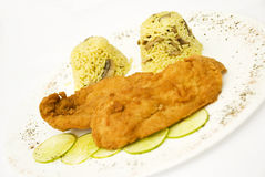 Chicken schnitzel with rice garnish Stock Photo