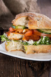 Chicken Schnitzel on a roll Royalty Free Stock Images