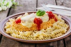 Chicken schnitzel with tomato sauce and mozzarella Stock Image