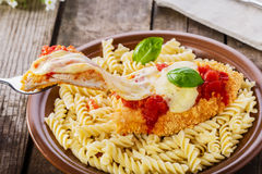 Chicken schnitzel with tomato sauce and mozzarella Royalty Free Stock Image