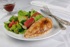 Chicken schnitzel with vegetable garnish Royalty Free Stock Images