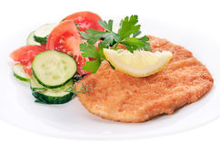 Chicken schnitzel with vegetables and herb Stock Image