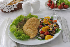 Chicken schnitzel with vegetables in sesame Stock Photo