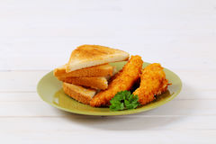 Chicken schnitzels with toasts Royalty Free Stock Image