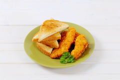 Chicken schnitzels with toasts Royalty Free Stock Photos