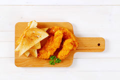 Chicken schnitzels with toasts Stock Images