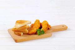 Chicken schnitzels with toasts Stock Photo