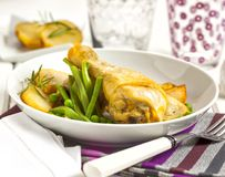Chicken served with potatoes, peas and beans stock photos