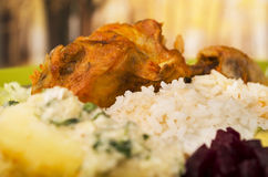 Chicken served with white rice potato on a plate Royalty Free Stock Image