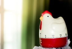 Chicken shape of Timer with the left of sun light Stock Photo