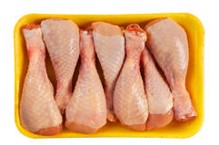 Chicken shin in packing. On white background Royalty Free Stock Images