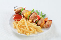 Chicken Shish kebab with French fries. And ketchup Stock Images