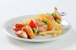 Chicken Shish kebab with French fries Stock Photos