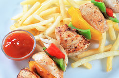 Chicken Shish kebab with French fries Royalty Free Stock Images