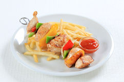 Chicken Shish kebab with French fries Royalty Free Stock Image