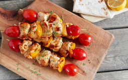 Chicken shish kebab with pepper tomato wooden skewer Stock Images